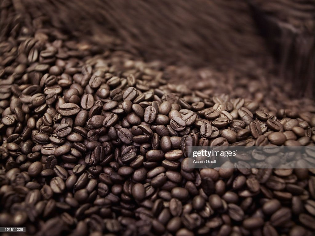 Close up of coffee beans in roasting process : Stock Photo