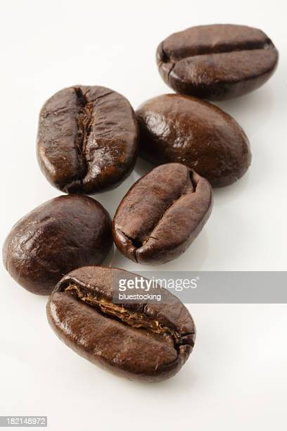 Close up of coffee beans on white background