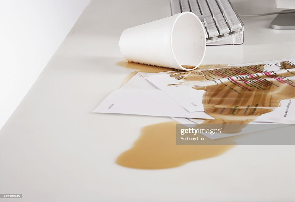 Close up of coffee spilled on paperwork