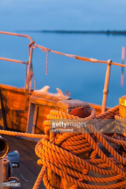 Close up of coiled rope on boat