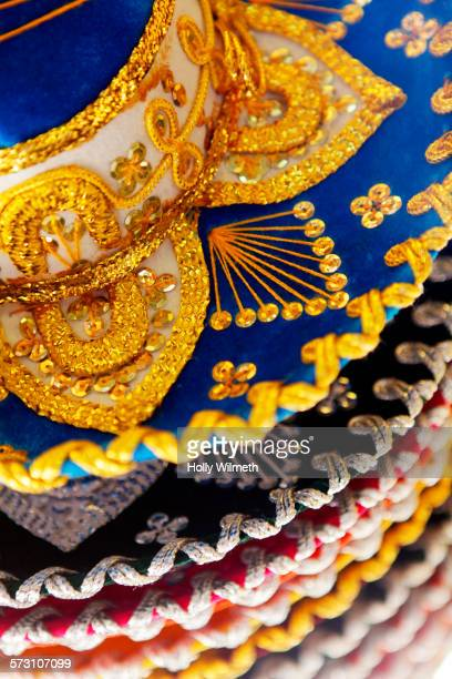 Close up of colorful embellished hats