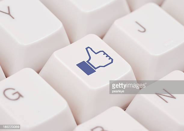 Close up of computer key with Facebook like logo