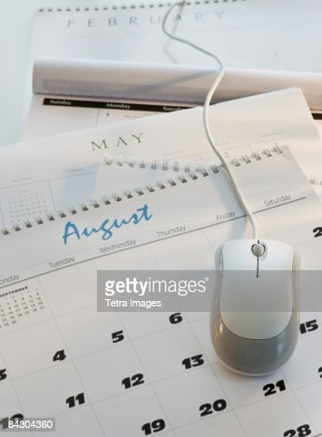 Close up of computer mouse on calendar : Stock Photo