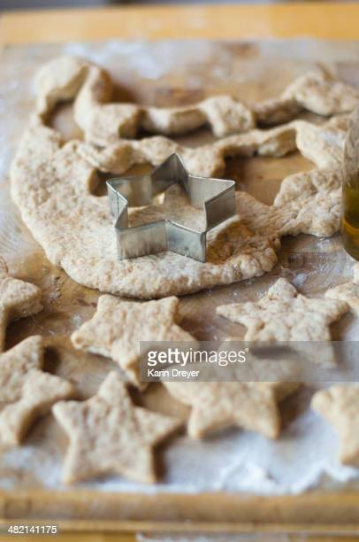 Close up of cookie cutter and dough