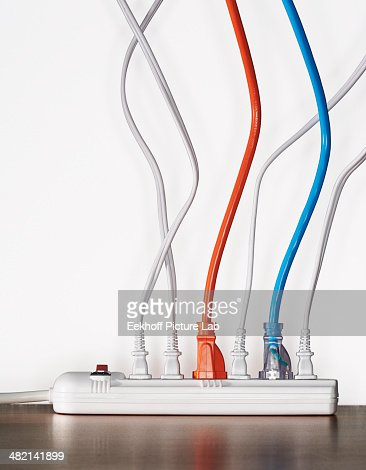 Close up of cords plugged into power strip