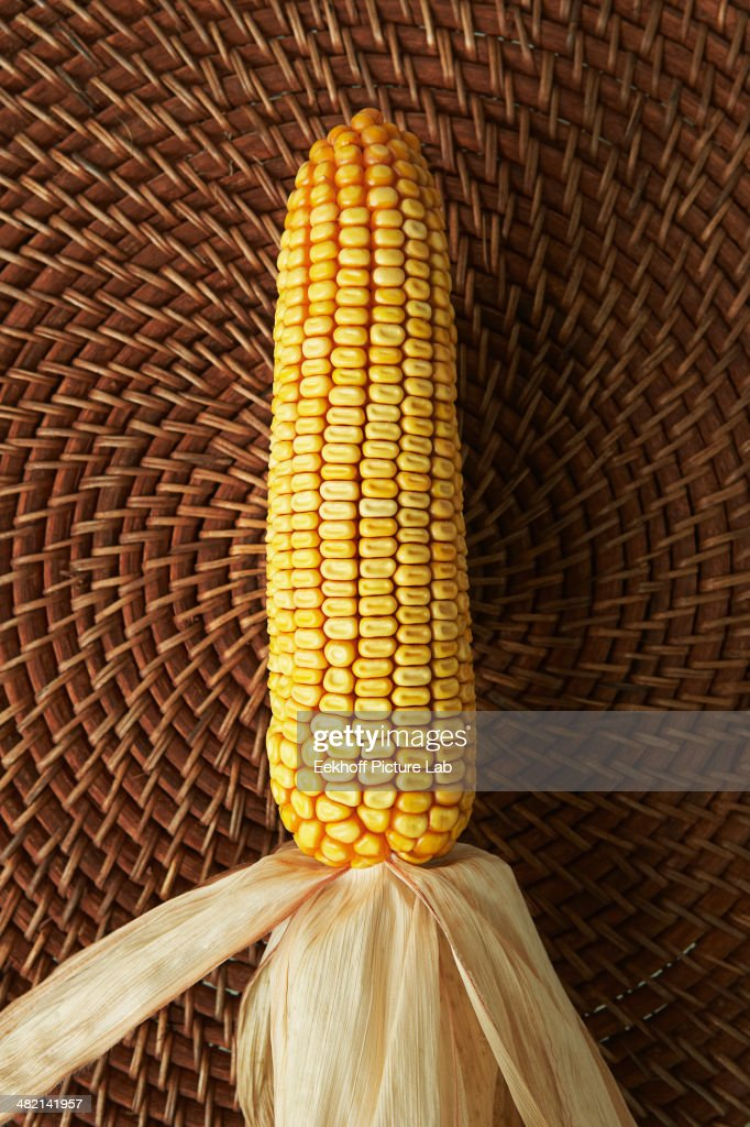 Close up of corn cob on woven placemat