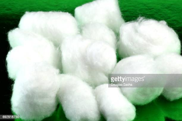 Close up of cotton balls on a green background