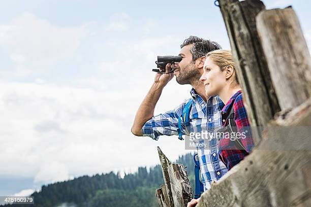 Close up of couple enjoying view through binoculars, Tirol, Austria