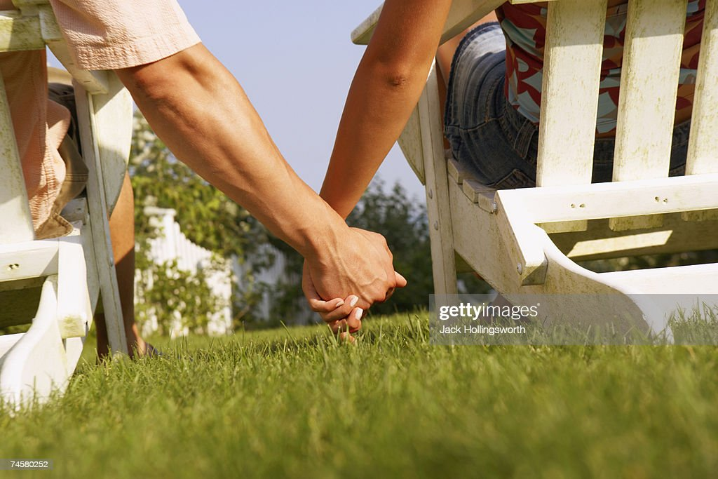 Close up of couple holding hands : Stock Photo
