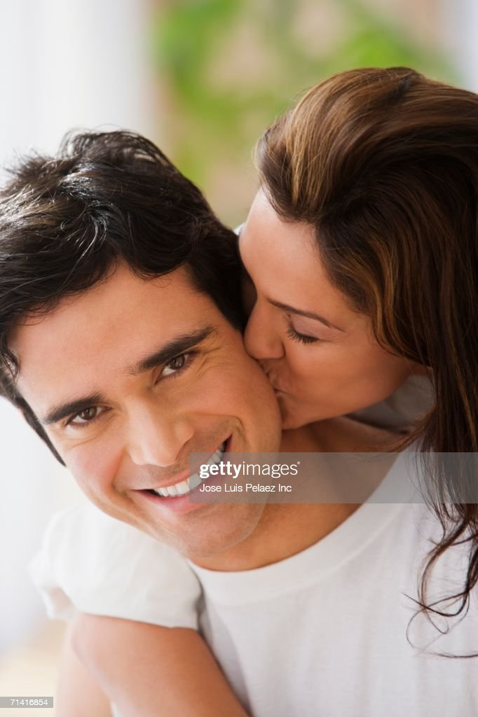 Close up of couple hugging and kissing : Stock Photo