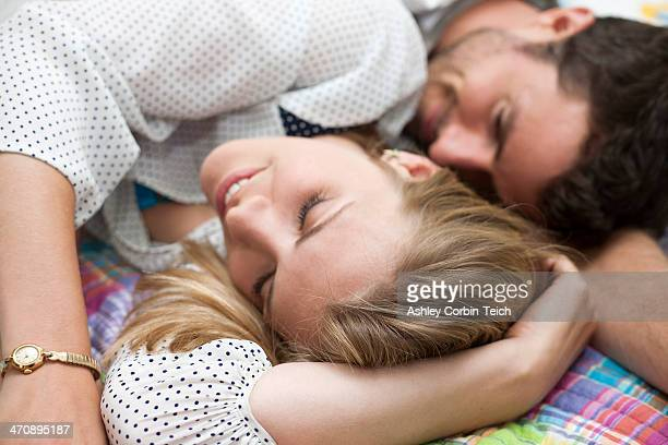Close up of couple relaxing on bed