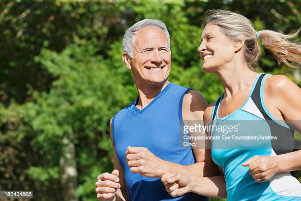 Close up of couple running together