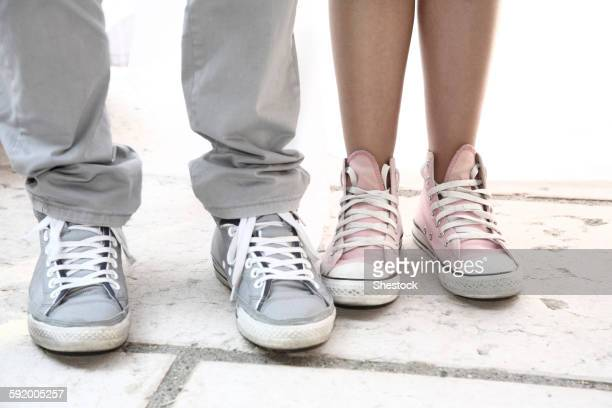 Close up of couple wearing sneakers