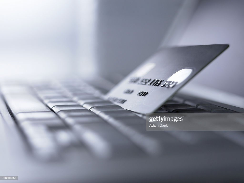 Close up of credit card on computer keyboard : Stock Photo