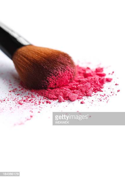 Close up of crushed cosmetic and brush