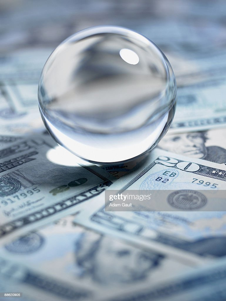 Close up of crystal ball on 20 dollar bills : Stock Photo