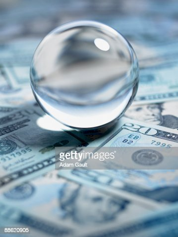 Close up of crystal ball on 20 dollar bills : ストックフォト