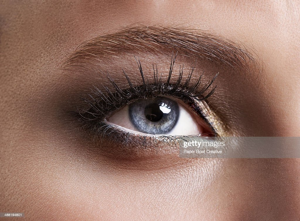 Close up of crystal blue eyes looking at the light