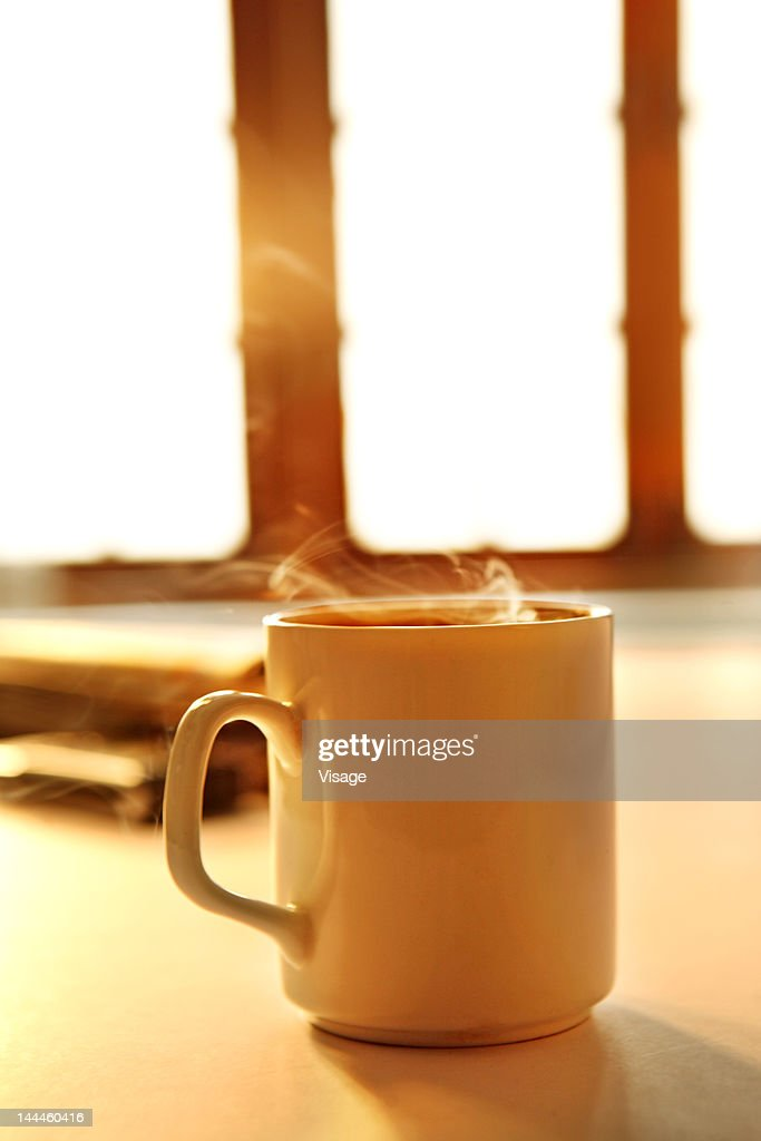 Close up of cup of steaming coffee : Stock Photo