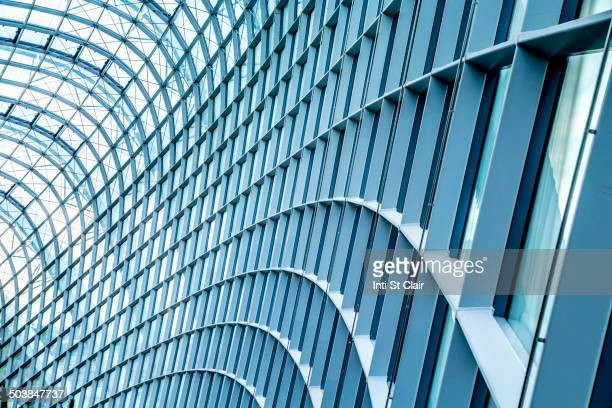 Close up of curved metal and glass building