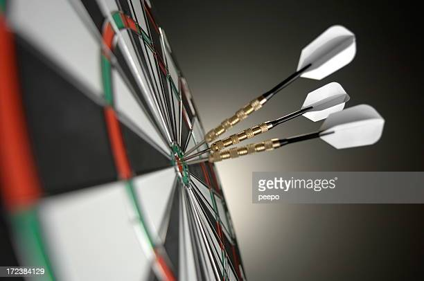 Close Up Of Darts in Bullseye