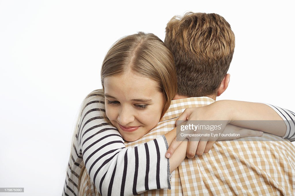 Close up of daughter hugging father : Stock Photo