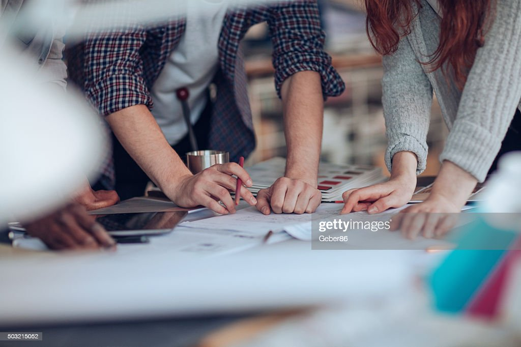 Close up of designers hands : Stock Photo