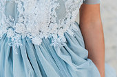 Close up of details on a light blue wedding dress for a beach wedding