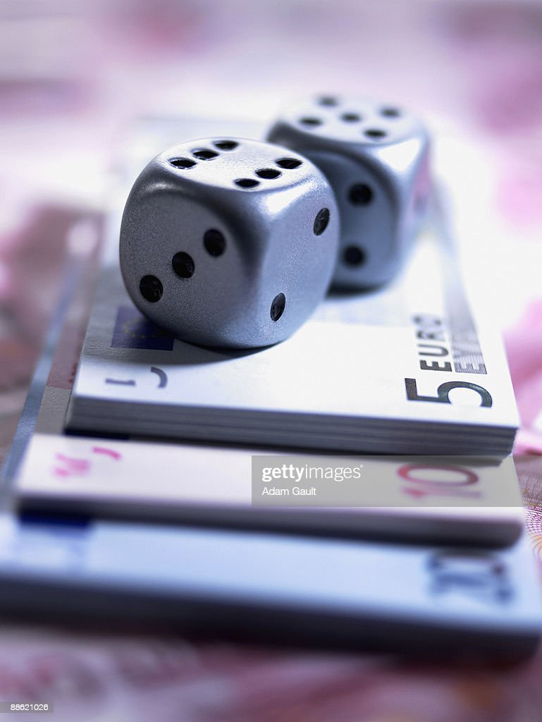 Close up of dice and euro notes : Stock Photo