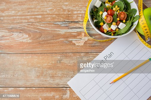 close up of diet plan and food on table : Stock Photo
