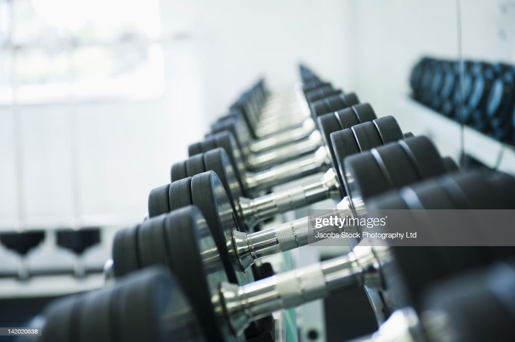 Close up of dumbbells in health club : Stock Photo