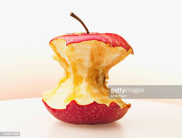 Close up of eaten red apple