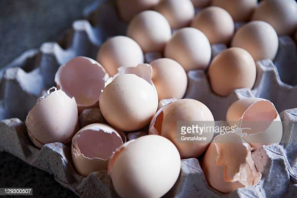 Close up of eggshells in carton