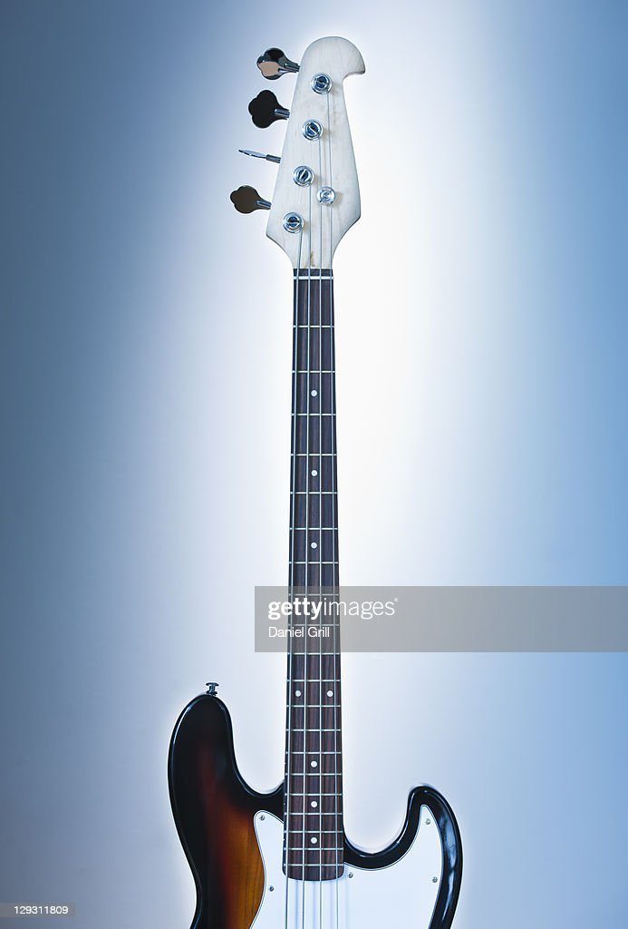Close up of electric guitar on blue backgrounds
