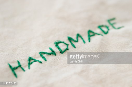 Close up of embroided handmade word, studio shot : Stock Photo