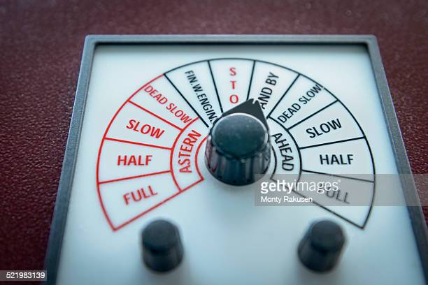 Close up of engine speed controls on container ship