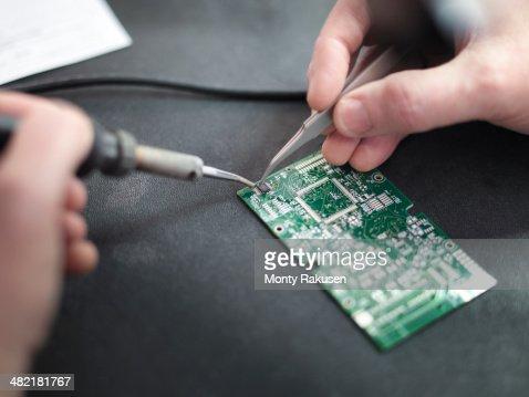 Close up of engineer soldering prototype circuit board