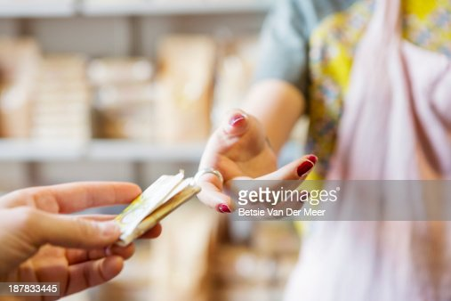 Close up of exchange of money in shop.