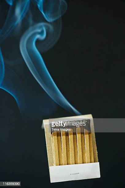 Close up of extinguished matches with smoke
