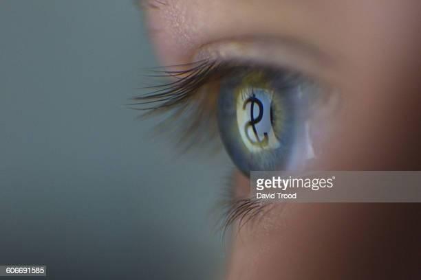 Close up of eye reflecting dollar sign in ipad