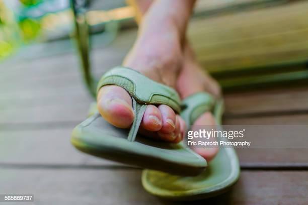 Close up of feet of man wearing flipflops