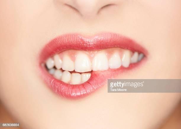 close up of female biting lips