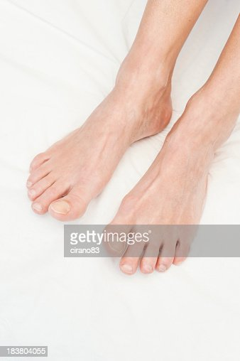 Close up of female feet on beauty treatment bed stock for Beauty treatment bed