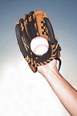 Close up of female hand holding ball wearing baseball glove, Miami, Florida, USA