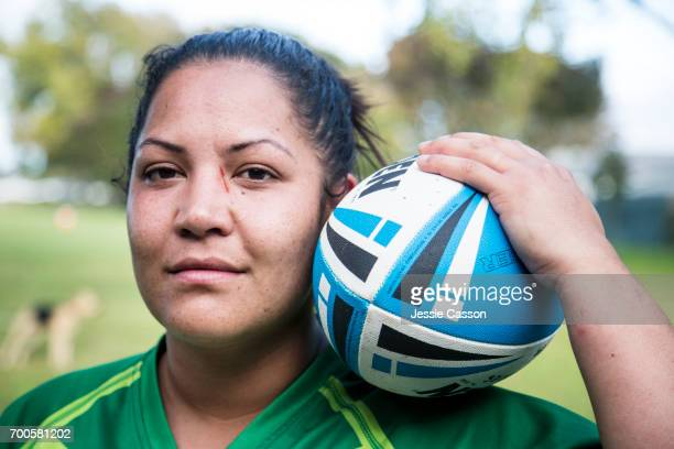 Close up of female rugby player holding ball