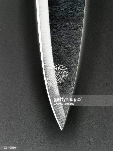 Close up of fingerprint on knife blade