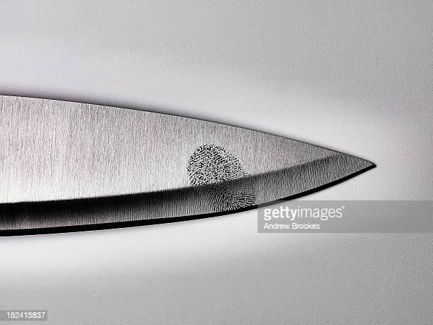Close up of fingerprint on knife blade