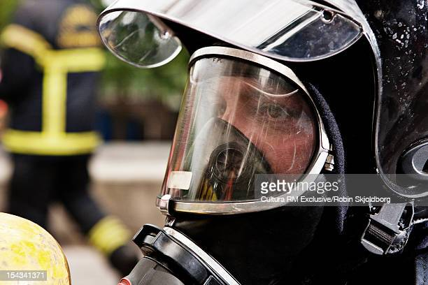 Close up of fire fighter wearing mask