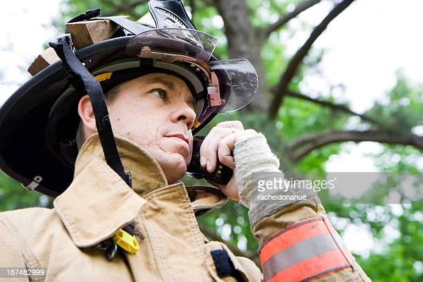Close up of fireman talking on radio