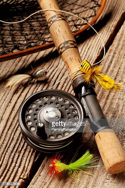 Close up of Fly-Fishing equipment on wood Background.